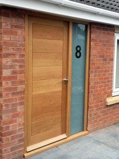 Modern front door in solid oak. This isn't engineered/veneered, it's solid, beautiful, timber. Made by The Bespoke Door Company.