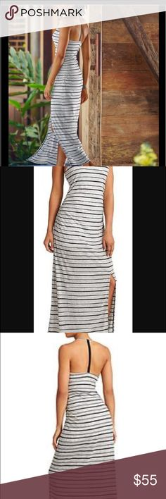 Stripe Serenity Maxi Dress Black and faded gray stripe maxi dress from Athleta.  A high cut neck (cups included) keeps you secure while the white liner prevents anything from showing through this sexy yet demure dress.  Side ruching and a one sided split in the skirt keeps this from being any old maxi dress however.  Size medium, fits an 8-10, worn once. Athleta Dresses Maxi