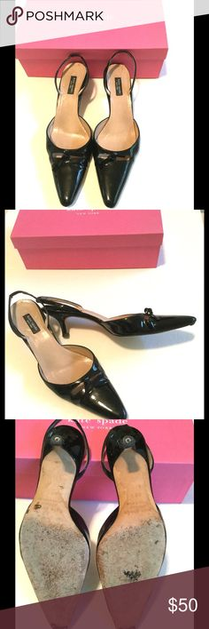 Kate Spade Isobel Black Patent Kitten Slingbacks Adorable black patent kitten heel slingback shoes with bow detail on pointy toe.  Kate Spade, stored in original box.  Some wear on heels, and heel pad due to be replaced (quick $5 fix at shoe cobbler). kate spade Shoes Heels