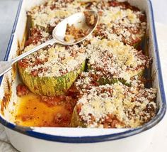 Stuffed marrow bake 1 tbsp olive oil 1 onion , chopped 1 garlic clove, crushed 1 tbsp dried mixed herbs pack turkey mince 2 x cans chopped tomatoes 1 marrow , cut into thick slices 4 tbsp breadcrumbs 3 tbsp grated Parmesan Bbc Good Food Recipes, New Recipes, Cooking Recipes, Healthy Recipes, Healthy Foods, Family Recipes, Delicious Recipes, Recipies, Cooking On A Budget