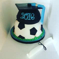 2016 graduation cap on soccer ball cake by Angelino Cakes