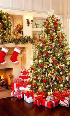 Christmas tree with red and white ornaments and presents