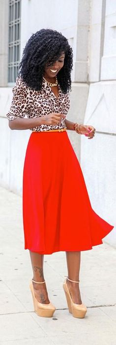 how to wear leopard print,Red and leopard is such a bold combination. I love how the blouse looks with this skirt.