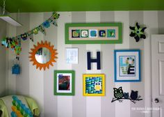 Fun gallery wall with vertical stripes and green ceiling! #gallerywall #stripes #nurserydecor