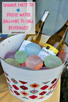 Keep beverages cold with frozen water balloons. It adds a bit of color and fun to the beverage bucket, don't you think?