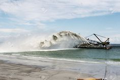 Picture of Dredging , panning sand on the beach during the construction of a new sea freight terminal in the harbor of Port stock photo, images and stock photography. Niagara Falls, Construction, Sea, Stock Photos, Pictures, Photography, Travel, Inspiration, Image