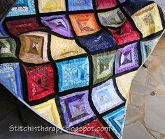 """Faceted Jewels is a string quilt sewn onto foundation muslin.  Each large square  has a diagonal black strip dividing the 2 color families in that block.   I created a """"road map"""" planning sheet to use as a  guide for color placement.  This one is lots of fun to work on and can be as large or small as you like."""