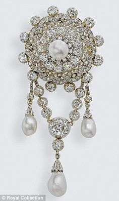 This brooch was a gift to Princess Mary Adelaide, Duchess of Teck (Queen Mary`s mother) from the Emperor of Austria when he stood as Godfather for her son Prince Francis of Teck. Sometimes the Queen wears the brooch without the suspended chain & drop pearls.