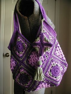 Inspiration -- DIL loves purple.  Pattern by Dawn Davis, available in her etsy shop http://dawndavis.blogspot.com/search?updated-max=2010-07-25T19%3A23%3A00-04%3A00=7  #crochet #bag #color #purple