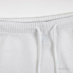 Short blanco de punto con cuerditas para bebé de Mon Marcel. #baby #trousers #fashion #NeroliByNagore #SS14 #MonMarcel