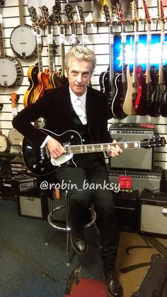 Peter Capaldi playing guitar in Cardiff music store. #PeterCapaldi #DrWho #Legend #Cardiff #@robin_banksy