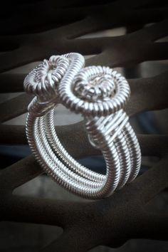 Sterling silverplated wrapped ring Lussekatt by SleipnerStudios. $40.00, via Etsy.