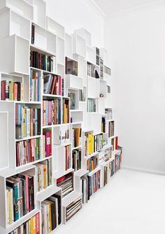 {3D wall of shelving} love the unevenness of this shelving!