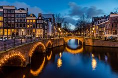 Amsterdam canals (The Netherlands). 'Amsterdam has more canals than Venice, and getting on the water is one of the best ways to feel the pulse of the city. You could catch the vibe by sitting canalside and watching boats glide by. Better yet, hop on a tour boat and cruise the curved passages. From this angle, you'll understand why Unesco named the 400-year-old waterways a World Heritage site.'