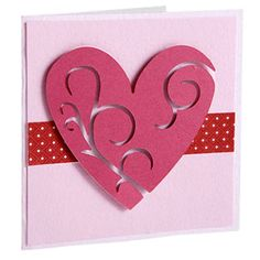 Die-Cut Your Main Valentine's Day Embellishment  Design by Michelle Rubin  Michelle used a die-cutting tool to create a large intricately cut heart, then attached it to a lighter shade of pink cardstock using adhesive foam.  Editor's Tip: Sometimes you don't need a sentiment to show the meaning of the card. Michelle skipped the words and let her die-cut heart be the focus.