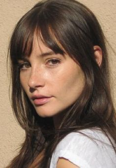 Sparse whispy fringe, cut lash length and tapered to cheekbone length, worn…