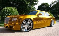 Imagine pulling up in one of these babies! #gold #chrysler
