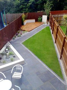 traditional design with contemporary space, deck, hardscape and grass