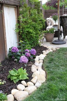 Outdoor Garden Edged with White Rocks #landscapingideas