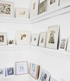 Simple, Lovely Ideas for White Rooms Simple ledges display family photos in the living room.Simple ledges display family photos in the living room. White Rooms, White Walls, Design Studio, House Design, Old Basement, Basement Stairs, Picture Shelves, Picture Ledge, Photo Ledge
