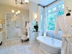 Master bath w/ his/her sinks and S.V. Robes w/ built in TV for watching in bath.