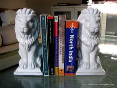 spray painted dollar store garden statues into bookends