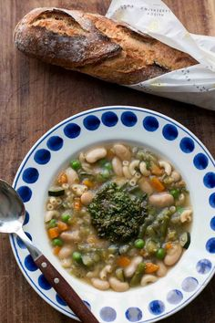 French summer vegetable soup with a generous mound of fresh basil puree in the center to swirl in!