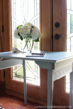 Antique folding sewing table.