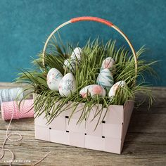 Basket Case Easter is on its way and we have just the project for you. This woven paper basket with Easter grass is a great place to keep your sweets and treats. Whether you hide your baskets or put them on display, this one will certainly wow on Easter morning. We've included instructions for both...