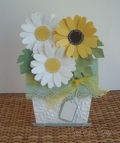 handmade card ... flower pot style ... like these daisies with so many petals and white dots on the centers ...