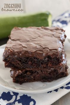 Zucchini Brownies - the easiest recipe for the most gooey, chocolaty, fudgy brownies full of zucchini! And NO ONE will guess!