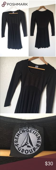 Vintage 90s Black Skater Dress Stretch material black 90s a-Line long sleeve skater dress. The top is a textured fitted material and the bottom flows out. Does not have a size but would fit an xs/s has a stretch material. Vintage Dresses Mini