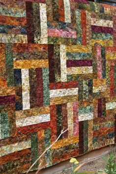"""Autumn is in the air and this Handmade quilt will bring the warm shades of Fall into your home. This lap sized quilt is made of Cornucopia batiks."""