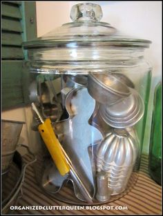 Vintage Kitchen Decor; pile cookie cutters etc in a jar--particularly the vintage Christmas ones