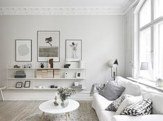 I love the cleanliness of fresh white walls, just like in this white homein Gothenburg. The space looks so light and airy, especially with the painted white floorboards in the kitchen and sanded floorboards in the living space. It sets off those black Arne Jacobsen Series 7 chairsand mid-century dining table nicely – I often think furniture like that looks best against a plain backdrop. And you know how I can't resist a set of String shelves! Normally you would think to put them halfway…
