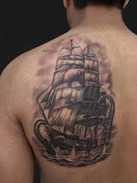 Black pirate ship with the tentacle of the octupus With a red smoke ship and black color octopus' tentacles medium size tattoo located at the left side of the shoulder.  - Download