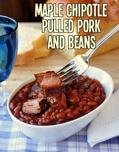 Maple Chipotle Pulled Pork and Beans - a favorite Slow Cooked Sunday meal from my first cookbook that has been incredibly popular online as well. Chunks of tender pork,, slow coked with the baked beans is one delicious combination in a perfect comfort food meal.