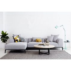 Level 2. Cushions, floor rug, coffee table, side table, lamp, houseplant