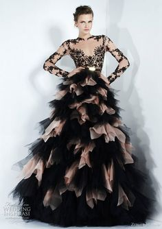 Black dotted netting over pale pink strapless dress.