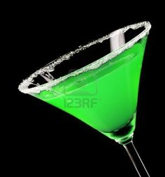 Martini glass with green coctail