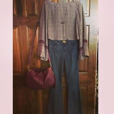 Rock the boho chic look this fall with a pair of flare jeans and a loose top with muted plum tones! #BohoChic #FallFashion #FallTones #IHeartHobo #PaigeDenim #FreePeopleStyle #ShopLocal #DetailsBoutique