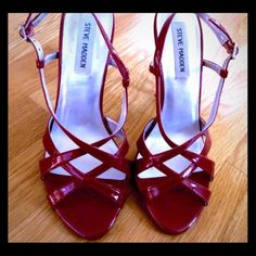 "STEVE MADDEN - Red patent strappy heels! A stunning cherry red sandal, size 7.5 Medium, all man-made shiny patent material.  Minimal wear, only on soles.  The red upper is pristine.   EUC!  Heel aprx 4"" high.  Love these shoes, but can't do a 4"" heel these days.    Thanks for looking.   Bundle 3 or more items for 20% discount!  10.28.15.35 Steve Madden Shoes Heels"