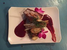 One of our specials this week....seared amberjack with mulled cranberry wine sauce & braised white asparagus from North Beach Grill.