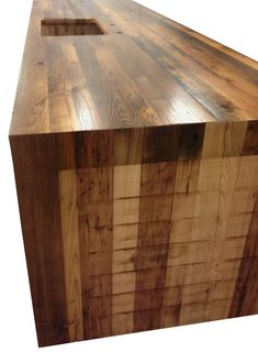Reclaimed Chestnut Pastore Waterfall Countertop with a 1/8″ Roundover on top, bottom and vertical corners of all edges and a Durata® permanent finish in satin. https://www.glumber.com/image-library/reclaimed-chestnut-pastore-waterfall-counter-in-virginia/