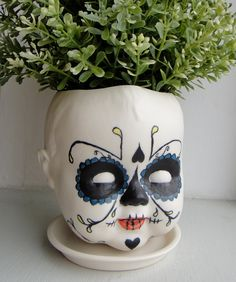 Halloween Edition Sugar Skull, Day of the Dead Baby - Porcelain Baby doll head planter. $85.00, via Etsy.