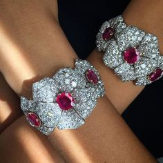 Cartier cool cuffs!! Ruby and diamond bracelets, with yellow gold and diamond backchains, circa 1960. From our Paris Jewels auction, 6 December. @christiesjewels @christiesinc #christiesjewels #christiesinc #christies #christies250 @cartier #diamond #burmeseruby #bracelet #paris #france