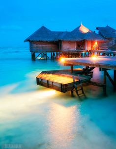The Ultimate over water villa >>> beautiful! I want to go swimming now :)