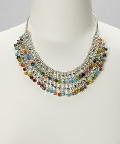 Make an accessory statement with this colorful necklace. A mosaic of square beads and polished silver metal create chic contrast.
