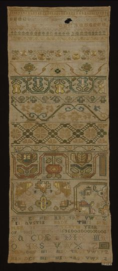 """Ann Austin 1691 Natural  colored linen embroidered in bands of floral and geometric designs with soft green, blue, pink, and yellow silks. At the bottom is embroidered the alphabet and this inscription: """"Ann Austin made this sampler in ……tenth year of her age1691""""."""