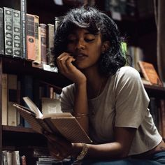 books + jewelry + dark lipstick + crop tops + glossy hair